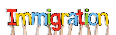 Hands Holding Immigration Word Concept 版權商用圖片