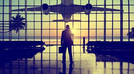 businessman waiting call: Businessman Airport Travel Waiting Trip Terminal Concept
