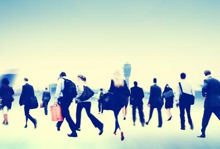 rushing: Business People Rushing Walking Airport Travel Concept