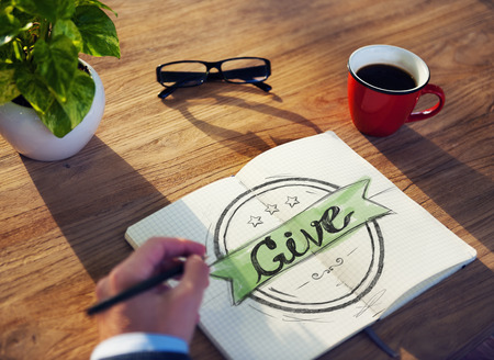 deeds: Businessman Writing the Word Give