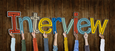 job recruitment: Group of Hands Holding Interview Word Concept