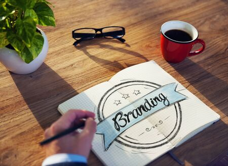 business words: Man with Note Pad and Branding Concept Stock Photo