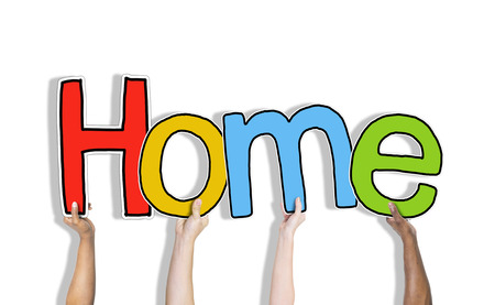 diversity domain: Hands Holding the Word Home Concept