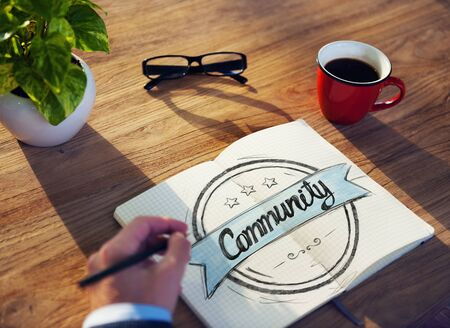 note pad and pen: Man with Note Pad and Community Concept Stock Photo