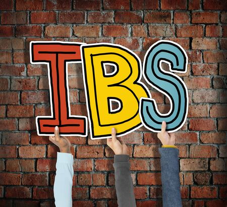 bowel wall: Group of Hands Holding IBS Letter