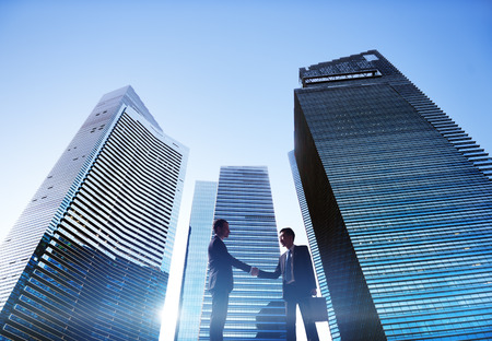 global partnership: Businessmen Cityscape Handshake Partnership Concept Stock Photo