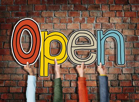 unclosed: Multiethnic Group of Hands Holding Word Open Stock Photo