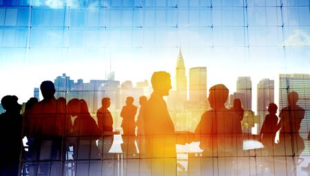 communication occupation: Back Lit Business People Cityscape Meeting Concept Stock Photo