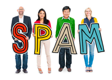 mixed age: DIverse People Holding Text Spam Stock Photo