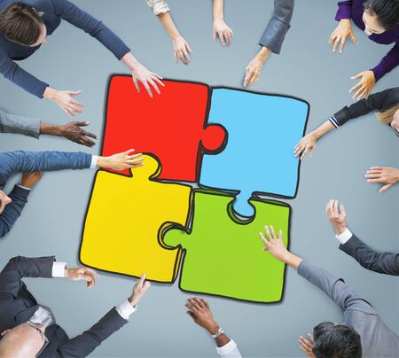 hands work: Group of Business People Forming Jigsaw Puzzle Stock Photo