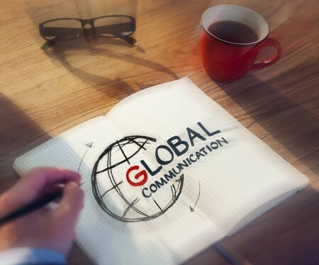 communications: Man with a Note and Global Communications Concept Stock Photo