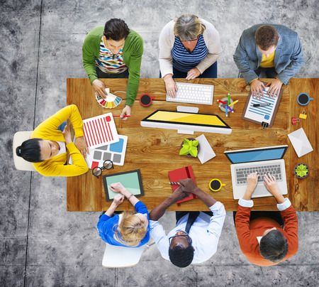 discussing: Business People Design Team Brainstorming Meeting Concept Stock Photo