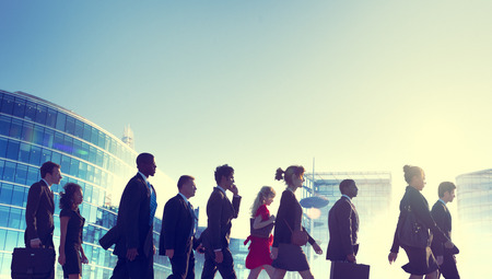 Group of Business People Walking Back Lit Concept Stock Photo