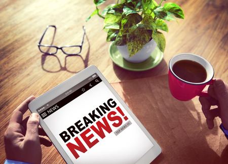 read news: Businessman Holding Tablet News Concept