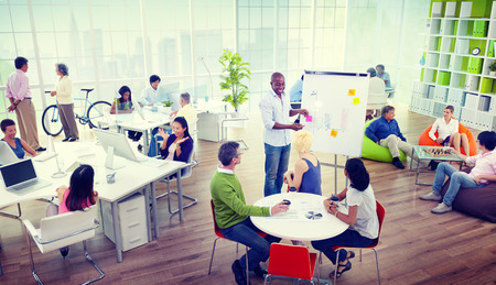 relaxed man: Group of Business People in the Office Stock Photo