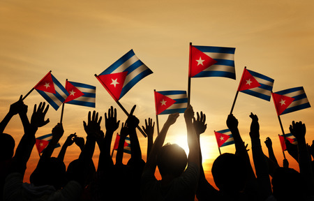 cuban culture: Silhouettes of People Holding Flag of Cuba