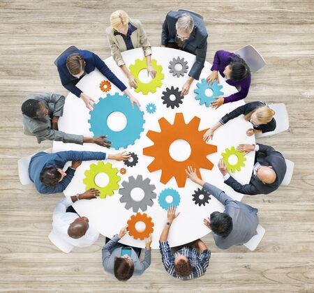 business gears: Group of Diverse Business People in a Meeting with Gears