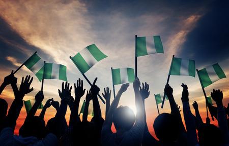 waving flag: Group of People Waving Flag of Nigeria in Back Lit