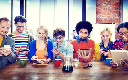 friendships: Diverse People Digital Devices Wireless Communication Concept Stock Photo
