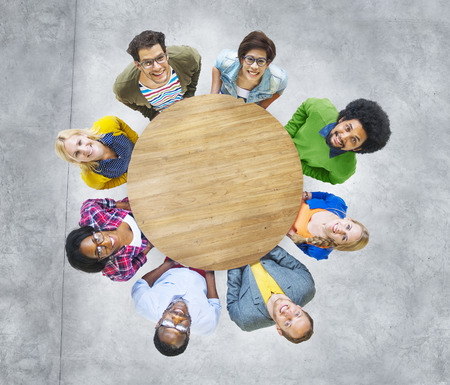 Aerial View Cheerful People Looking Up Conference Table Banco de Imagens