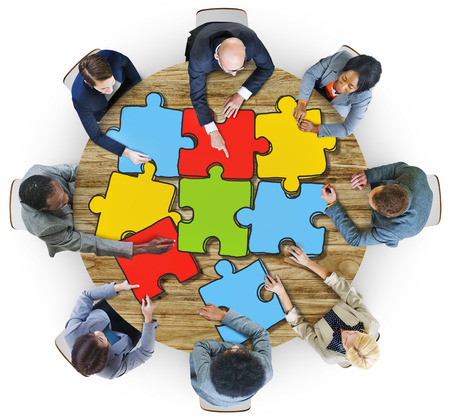 arms outstretched: Group of Business People with Jigsaw Puzzle in Photo and Illustration Stock Photo