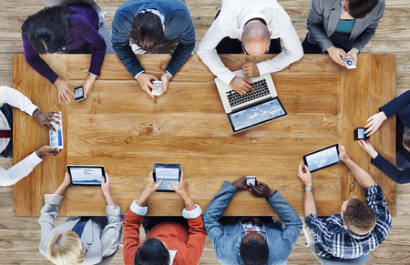 group cooperation: Group of Business People Using Digital Devices Stock Photo