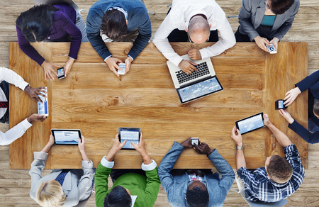 meeting place: Group of Business People Using Digital Devices Stock Photo