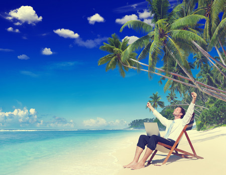 vacation destinations: Businessman Relaxation Vacation Working Outdoors Beach Concept Stock Photo