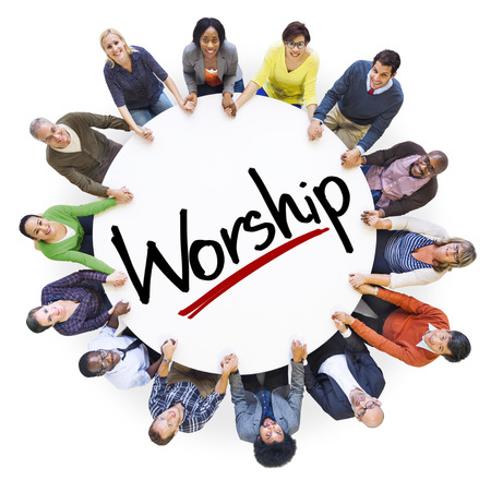 Group of People Holding Hands Around the Word Worship Stock Photo