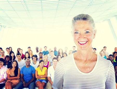 standing out from the crowd: Senior adult smiling and standing out from crowd