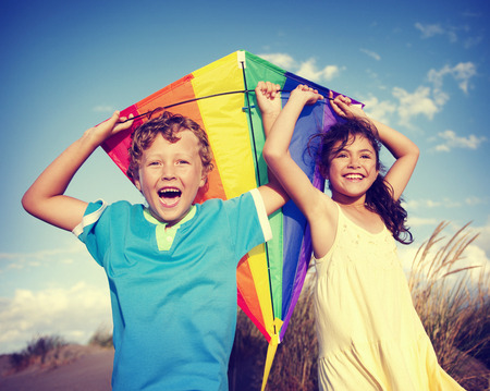kites: Cheerful Children Playing Kite Outdoors Concept