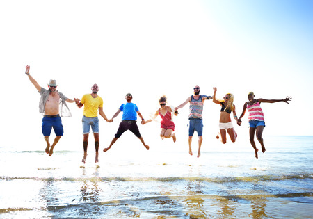 leap: Diverse Beach Summer Friends Fun Jump Shot Concept Stock Photo