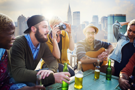 social gathering: Friends Hanging out Holiday Rooftop Happiness Concept