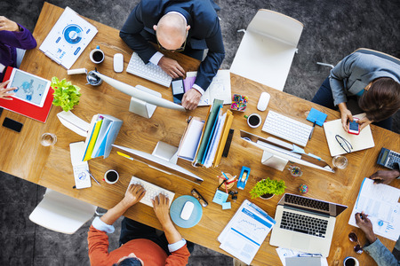 office desk: Group of Multiethnic Busy People Working in an Office Stock Photo