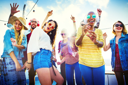 Friends enjoying themselves at a beach party Stock Photo - 41940681