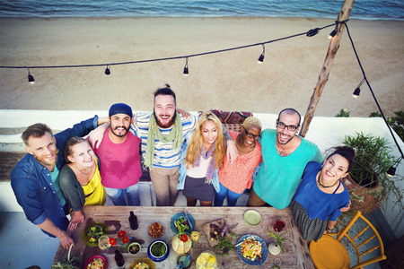 eating dinner: Beach Summer Dinner Party Celebration Concept Stock Photo