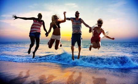 loving hands: Diverse Beach Summer Friends Fun Jump Shot Concept Stock Photo