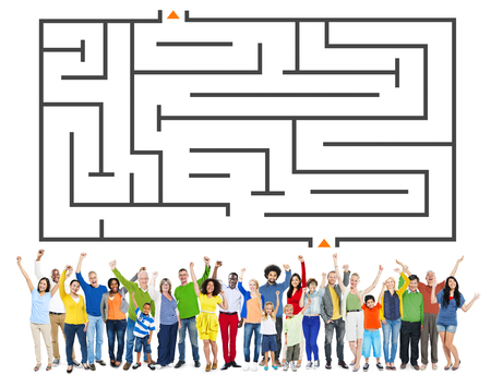 People standing under a maze Stock Photo