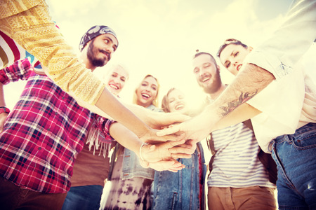 and activities: Friends Huddle Join Holiday Party Group Concept Stock Photo