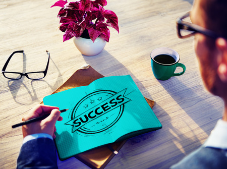 Man writing success on paper concept Stock Photo