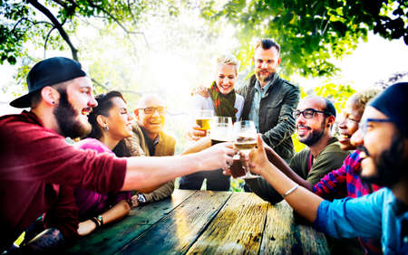 adult group: Diverse People Friends Hanging Out Drinking Concept