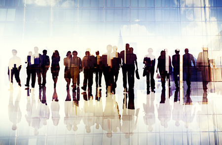 exterior architecture: Silhouettes of Business People in an Urban Scene