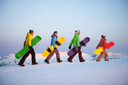 new zealand: Group of snowboarders on top of the mountain.