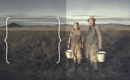 independent mongolia: Mongolian couple farmers holding basin and posing in the field. Stock Photo