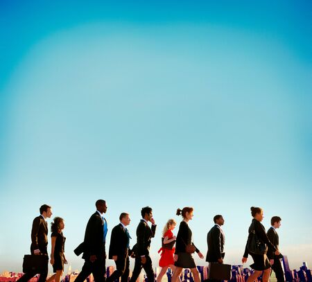businesspersons: Multiethnic Businesspersons Walking Rush Hour City Concept Stock Photo