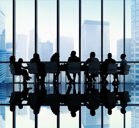 board room: Silhouette Group of Business People Meeting Concept Stock Photo