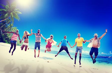 men friends: Diverse Beach Summer Friends Fun Jump Shot Concept Stock Photo
