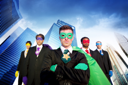 team power: Superhero Business People Strength Cityscape Concept Stock Photo