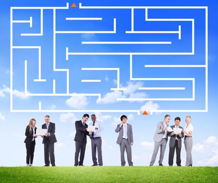Business people below a maze