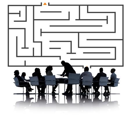 Business meeting under a maze